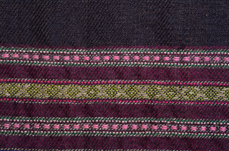 homespun: Texture of the old-fashioned homespun wool textile with various horizontal ornamental stripes Stock Photo