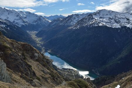 ridges: The Ossau valley with the lake Lac de Fabreges between the mountain ridges