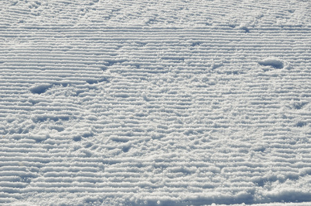 ski traces: The snow surface is prepared for alpine skiing.