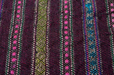homespun: Texture of the black vintage homespun wool textile with various vertical ornamental stripes