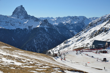 piste: The piste and the platter lift are photographed at the Artoust ski resort against the recognizable peak du Midi dOssau.