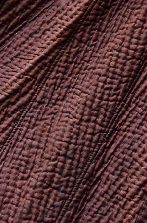 wadded: Quilted surface of the handmade wadded outer garment.