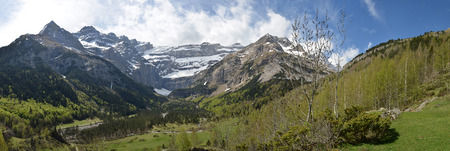 Spring mountains are photographed in the valley to the cirque of Gavarnie. This is a large rock amphitheater. Stock fotó