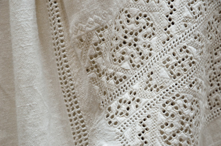 pierced: The handmade embroidery is worked with a white thread on the white ground. The geometric patterns are made by pierced eyelets, satin stitching, hemstitch and faggot stitching on the homespun cloth.