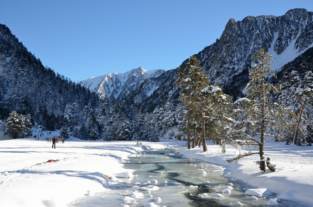 water skiers: Marcadau valley is a favourite place for cross country skiing and snow-shoe walking at both sides of Gave Marcadau in the Pyrenees national park. Stock Photo
