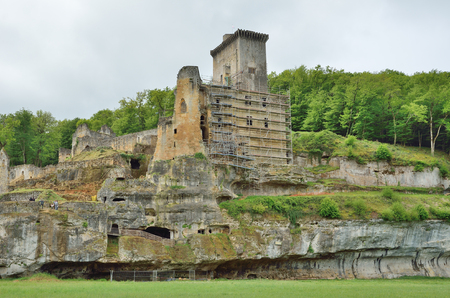 restoring: The ancient castle Commarque has been restoring on the forested hill since 1994.