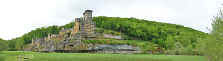 restoring: The ancient castle Commarque has been restoring on the forested hill in the green valley since 1994.