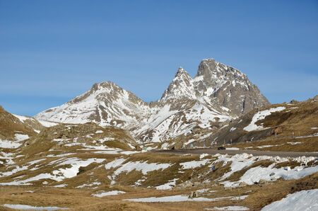 soft peak: The recognizable mountain Pico Anayet is slightly covered with snow in the vicinity of frontera del Portalet in the Aragon Pyrenees.
