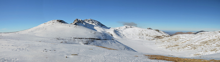 sledging people: Panoramic view of the snowy mountains with people sliding off-piste