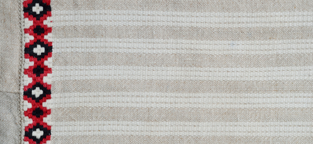 weaved: Linen homespun fabric is weaved with white stripes and decorated with embroidery.