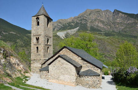 existent: Sant Joan de Boi church is a Roman Catholic church built of rough stones in the XII century. It has got three naves, only the apse and the Lombard style bell tower. Stock Photo