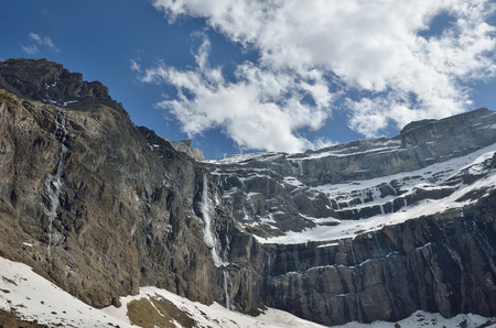 hollow walls: The cirque de Gavarnie is a large rock amphitheater. The cirques walls are twisted and layered. There are a lot of waterfalls and several peaks of over 3000m.