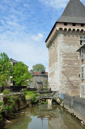 rebuilt: The old channel and the rebuilt tower are located in the old part of the French city Pau.