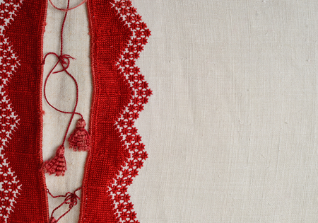 homespun: The white homespun shirt is decorated with handmade embroidery along the left side. The red pattern is made by pearl stitch. This is a traditional Ukrainian kind of satin stitch.