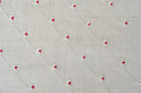 homespun: The white homespun cloth is decorated with handmade embroidery. Stock Photo