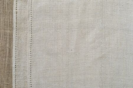 homespun: The white homespun cloth is hemmed with a handmade cut-and-drawn work along the left side. This is a typical hem stitch.