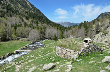 tourism in andorra: In the upper part of the Vall-de-Madriu-Perafita-Claror there are the high-altitude valleys with the mountain rivers, the alpine meadows and the forests. Stock Photo