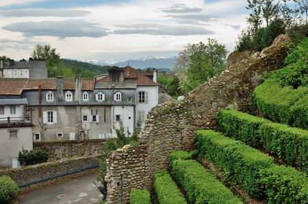 oldstyle: The old-style townhouses and the formal garden are located in the old part of the city. Stock Photo