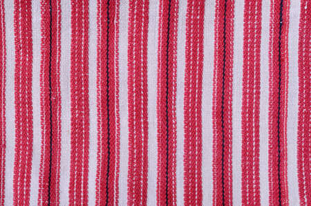 weaved: Linen homespun fabric is weaved with red and black stripes