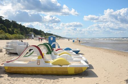 jurmala: Long Jurmalas beach is covered with white quartz sand. It is equipped with playgrounds, small benches, football fields and volleyball courts, various boats.