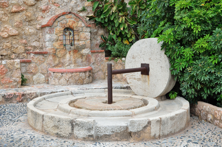 spanish village: Antique press and a source exist in the Spanish village Miravet.