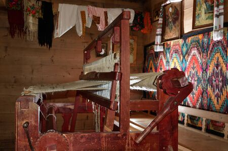 existent: Typical Hutsul apparatus for making a fabric by weaving wool yarn in the old room of the traditional Hutsul house