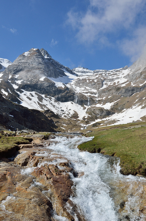 cirque: The mountain stream is rapidly flowing on the stone bed along the Heas valley from the cirque of Troumouse. Stock Photo