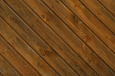 treated board: An old surface is diagonally made of the wooden boards with knots