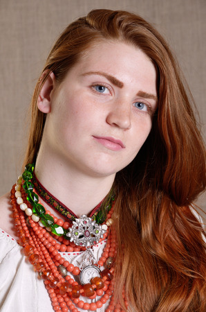 ukrainian ethnicity: The modern young woman is wearing a Ukrainian typical multiple necklaces with a pendant.