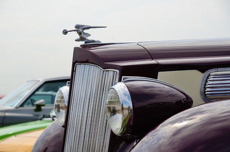 womanlike: The hood with the woman-like figurine of the old-fashioned automobile Packard