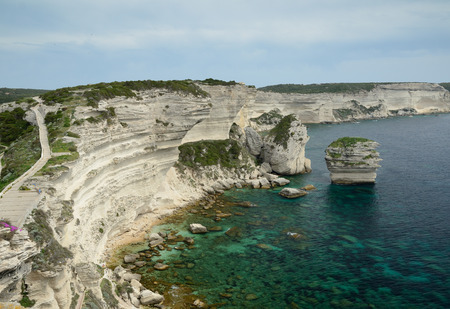 overhang: There are transparent water, limestone rocks and the white overhang cliffs in the seashore of the Bonifacio. Stock Photo