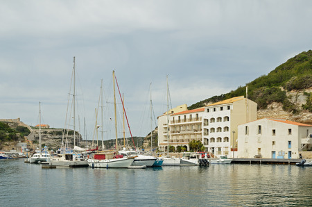 literas: There are many various vessels in the harbor and the hotels on the narrow shelf in the bottom part of Bonifacio.