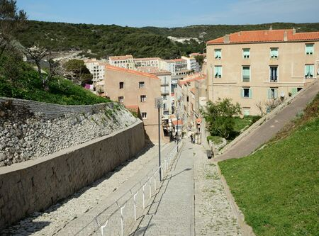 ancient pass: The ancient steep street with a modern stairway between the upper and down parts of Bonifacio Stock Photo