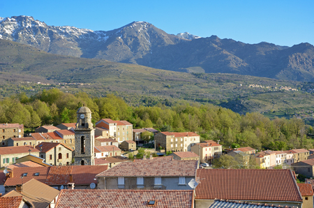 roof ridge: Corsican village Casamaccioli is situated on the slopes of the mountain massif in the natural park of Corsica. There is the ridge of Cinto in the background. Stock Photo
