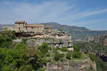 extant: The ancient small village is extant on the precipice in the Prades mountains.