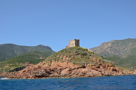 The coast with belfry in the Golfe de Girolata.