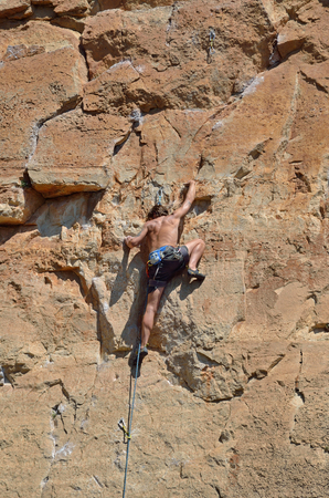 cragsman: The cragsman is climbing on the limestone vertical wall in the Prades mountains. Siurana is a world-class mountaineering destination. There are steep walls, slabs, overhangs and other limestone landforms. Stock Photo