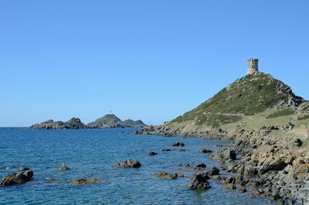 extant: Headland at Pointe de la Parata with the extant Genoese tower is situated near the Isles Sanguinaires (the Archipelago of the Sanguinaires) in the Corsican coast. Stock Photo