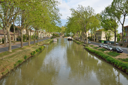 The Canal de Jonction runs through the French town Salleles dAude. This is a part of the La Nouvelle branch of the Canal du Midi. Editorial
