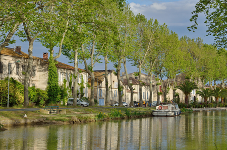 The Canal de Jonction runs through the French town Salleles dAude. This is a part of the La Nouvelle branch of the Canal du Midi. Stock Photo