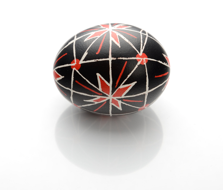 This is a pysanka with traditional Ukrainian ornaments and symbols. The Easter egg is decorated with a pattern using a wax-resist method. 스톡 콘텐츠