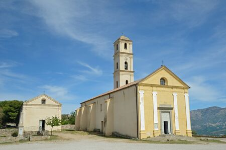 11th century: The hilltop village SantAntonino has an ancient church with a tall belltower. The Church of the Annunciation dates from the 11th century. Stock Photo