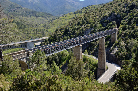 viaducts: The automobile and railway viaducts span the steep slopes in the Corsican mountains.