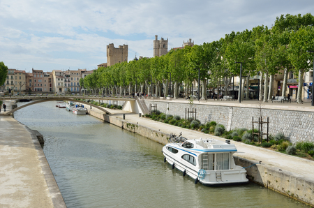 passerby: Ancient canal de la Robine runs through the center of the French city Narbonne. It is the third section of the La Nouvelle branch.
