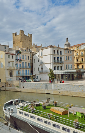 Ancient canal de la Robine runs through the center of the French city Narbonne. It is the third section of the La Nouvelle branch.