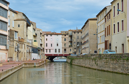 Ancient canal de la Robine runs through the French city Narbonne. It is the third section of the La Nouvelle branch.