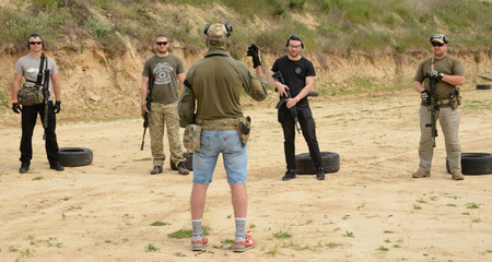 Kyiv, Ukraine - June 17 2017: The civil men are trained by the instructor at the outdoor shooting range during Editöryel