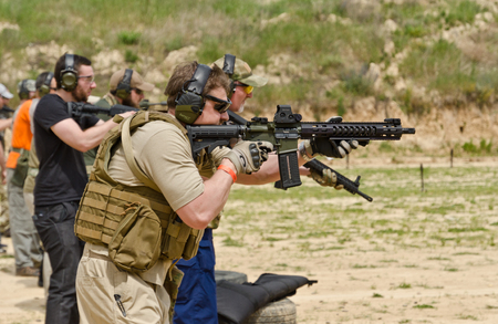 The civil men are trained to fire at the outdoor shooting range during Stok Fotoğraf - 86835254