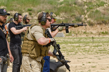 The civil men are trained to fire at the outdoor shooting range during Editöryel
