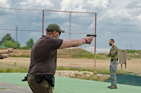 The civil man is trained to fire at the outdoor shooting range during Editöryel